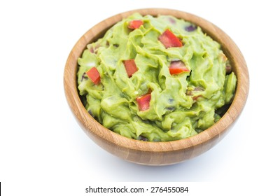 Guacamole in Wooden Bowl on White Background