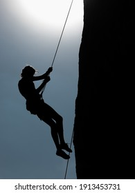 Guadalajara, Jalisco. January 1, 2021. Image of a man rapelling down the side of a rock after rock climbing.