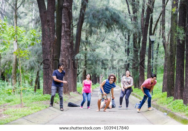 Guadalajara, Jalisco / Mexico - Circa 2016: Young adults have fun during summer season in a forest of the city named Colomos. Many people use their leisure time to take a walk in the forest.