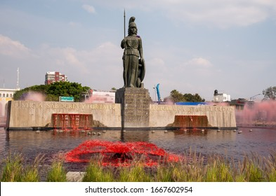 Guadalajara, Jalisco /  Mexico - March 8 2020: Water at Guadalajara's Minerva monument has been dyed red for International Women's Day, to protest the country's high rate of femicides.