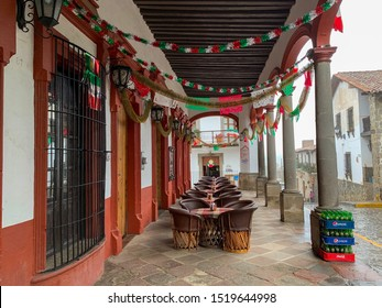 Guadalajara, Jalisco - September 30 2019: A street of the traditional village of Tapalpa with stone paved streets. Pepsi and coca cola glass bottles at La Villita cantina pub.