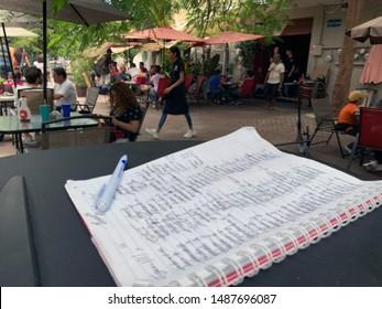 "Guadalajara, Mexico; August 25 2019: Colonia Americana, long wait list at ""La Antigua Waffles"" Waffle house on Plaza Juarez.Waffles for brunch"