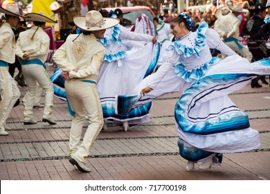 """GUADALAJARA, MEXICO - AUGUST 27: Dancers performing """"Jarabe Tapatio"""" during the 24th annual International Mariachi and Charreria Festival's parade, on August 27, 2017, in Guadalajara."""