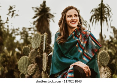 Guadalajara, Mexico - Circa 2017. Mexican white female model handling some ancestral handcrafts.