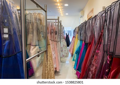 Guadalajara, Mexico - October 21 2019: Formal dress retail shop warehouse. Assorted formal dresses in different colors for sale in retail store.  Interior of formal gown shop