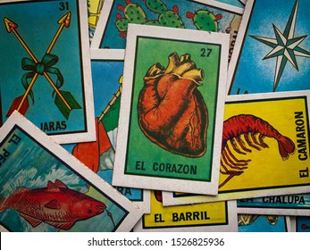 Guadalajara, Mexico - October 6 2019: Traditional lottery card game showing a number of traditional characters such as: Anatomical heart, shrimp, fish, stars and others