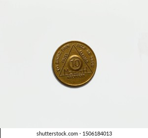 Guadalajara, Mexico - September 9 2019: AA sobriety chip awarded for abstaining from alcohol or other substance for 10 months. It is a token given to 12 step group members. Successful rehab