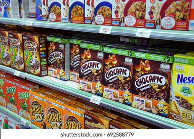 GUADALAJARA, SPAIN - AUGUST 9, 2017: Shelf with boxes of cereals of different types