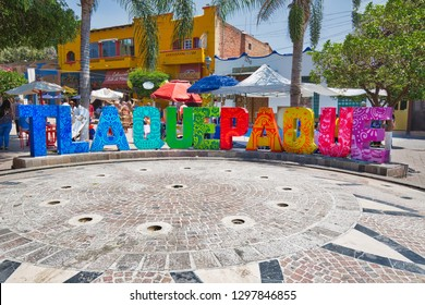 Guadalajara, Tlaquepaque, Mexico-20 April, 2018: Tlaquepaque art village colorful streets during a peak tourist season