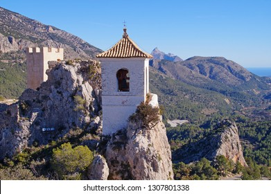 "Guadalest Castle known as the ""Eagle's Nest"" with the white Bell Tower in the Provence of Alicante, Spain"