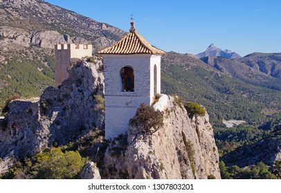 Guadalest Castle with the white bell tower in the Provence of Alicante in Spain