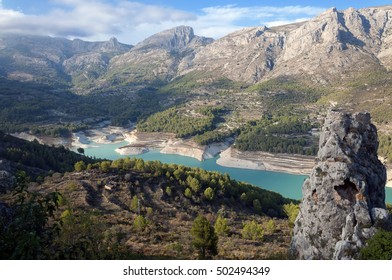 Guadalest Reservoir. Beautiful view of the valley with a dam and reservoir. Costa Blanca, Province of Alicante. Spain
