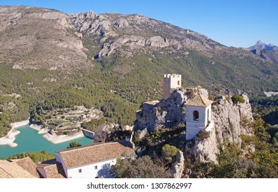 Guadalest village and valley with the beautiful green lake with mountains all around in Alicante province, Spain