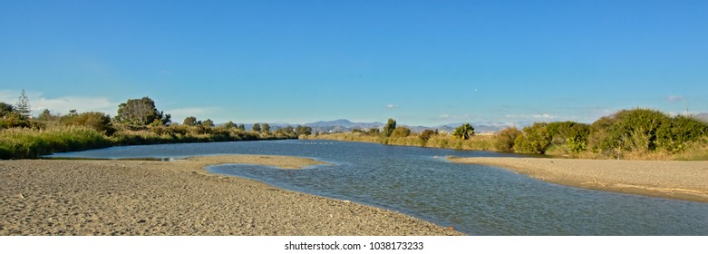 Guadalhorce river estuary seen from the beach of the mediterranean sea at Malaga, Spain. low angle panoramic view