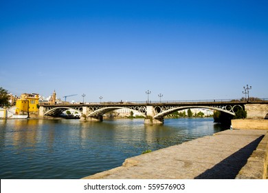 guadalquivir river on Triana bridge, Seville, Andalusia, Spain.