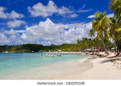 GUADALUPA - MARCH 2018: panoramic view of the beautiful sandy beach and crystal water of Caravelle's beach in Saint Anne, Guadeloupe