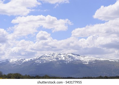 Guadarrama mountains range, in the province of Madrid (Spain). Sunny and cloudy morning of spring. Rests of snow in the summits.