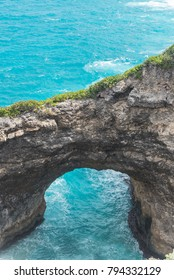 """Guadeloupe, Marie-Galante island, the hole """"Gueule Grand Gouffre"""", a beautiful seascape with a natural arch in the cliffs"""