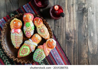 Guagua and colada morada, guagua de pan, wawas de pan, bread of the dead in Bolivia, Ecuador, Peru