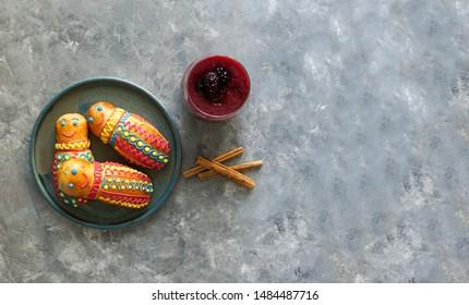 Guaguas de pan y colada morada, Figuras de pan ecuatorianas for Ecuador's Día de los Difuntos or Day of the Deceased          - Shutterstock ID 1484487716
