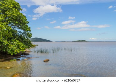 Guaiba lake with vegetation and island in background, Itapua, Viamao, Rio Grande do Sul