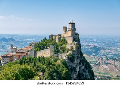 Guaita tower in the fortifications of San Marino on Monte Titano, with the City of San Marino on the left.