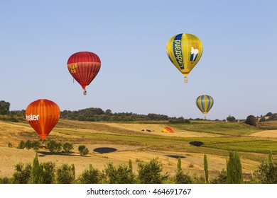 GUALDO CATTANEO, ITALY - JULY 31, 2016: Sagrantino International Challenge Cup. Colored balloons flies over a field.