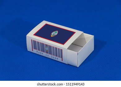 Guam flag on white box with barcode and the color of nation flag on blue background, paper packaging for put match or products. The concept of export trading from Guam.