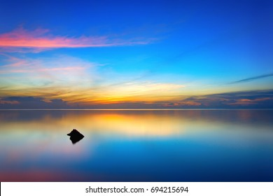 Guam.  Sunset.  The shallow waters around Agat offer a calm at sunset unlike anywhere else.  The quiet, the stillness, the beautiful colors; Amazing