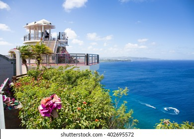 Guam, USA - March 05, 2016 : Tourists looking around the 'Two lovers point' in Guam on clear day.