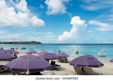 GUAM, USA - NOVEMBER 11, 2016: Tumon Beach in Guam, USA. Tourists are resting on the beach or are enjoying water sports. The beach is one of the most famous tourist attractions in Guam.