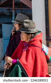 GUAMOTE, ECUADOR - OCT 18, 2018 : Ecuadorian indigenous woman dressed in traditional and colorful Andean clothes visiting the livestock market of Guamote, near Riobamba on October 18, 2018.