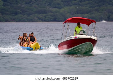 Guanacaste, Costa Rica- July 25: Family enjoying a banana boat ride  in Nacascolo Beach. July 25 2017, Guanacaste, Costa Rica.