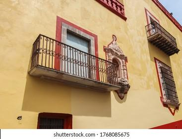 Guanajuato City, Mexico - 26th April 2016: Iron balcony and niche of colonial building in Guanajuato City