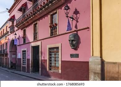 Guanajuato City, Mexico - 26th April 2016: A bronze face sculpture of Benemerito de las Americas outside the University of Guanajuato