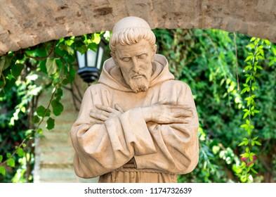 Guanajuato, Guanajuato Mexico, August 29 2018: St. Francis of Assisi statue in colonial garden in San Gabriel Barrera Guanajuato Mexico.