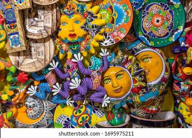 GUANAJUATO, MEXICO - FEBRUARY 15, 2020: Colorful traditional Mexican pottery. Talavera style. Souvenirs on sale in local market of Guanajuato, Mexico.