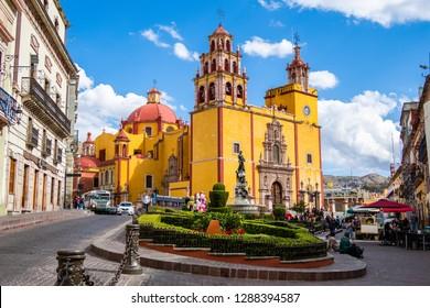 Guanajuato, Mexico - January 12, 2019: Basilica of Our Lady of Guanajuato cathedral and Plaza de la Paz in Guanajuato City, Mexico.