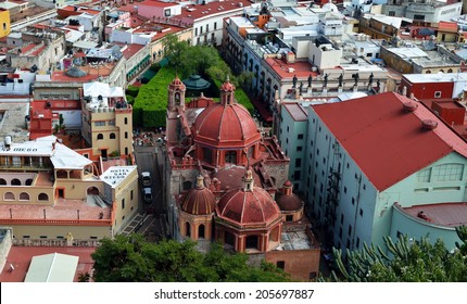 GUANAJUATO, MEXICO - NOVEMBER 2, 2013: Old cathedral and colorful 16th century colonial buildings in the valley of Guanajuato in central Mexico, World Heritage Site by UNESCO.