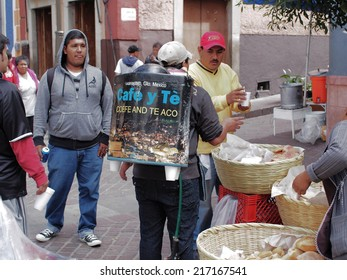 GUANAJUATO, MEXICO - NOVEMBER 2, 2013: Walking vendor sells hot coffee and tea. Photographed in the colonial city of Guanajuato. World Heritage Site by UNESCO.