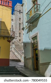 Guanajuato, Mexico- November 9, 2017:colorful buildings with architectural lines and details, with a peek-a-boo view of the University of Guanajuato steps and building