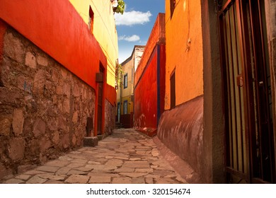 GUANAJUATO, MEXICO - September 24, 2015: Narrow public alley street view of Guanajuato City, the UNESCO World Heritage Site. 16th century old buildings & streets are preserved.