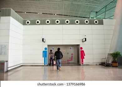 GUANGDONG, CHINA - MAY 10 : Chinese people and foreigner passengers go to toilet inside of Jieyang Chaoshan International Airport at Shantou town or Swatow city on May 10, 2018 in Guangdong, China