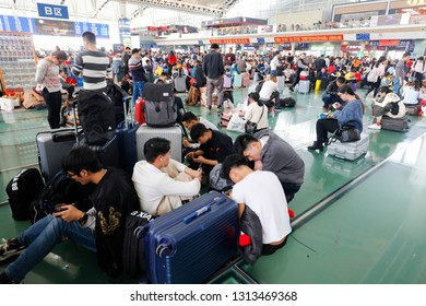 GUANGDONG CHINA-January 30, 2019: Passengers wait at the Guangzhou railway station. China's transport network is gearing up for millions of travelers during the annual Chinese Spring Festival.