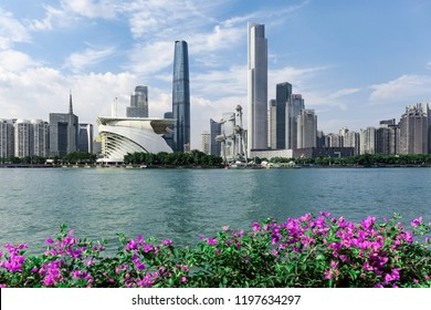 GUANGHZOU, CHINA - September 02, 2018: Guangzhou Tower or Canton tower, Dusk view of the Canton tower as seen from the Flower Square in Guangzhou, China. modern office buildings near river in midtown