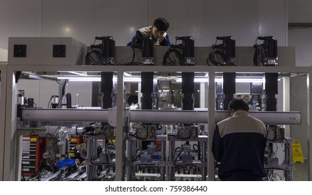 GUANGZHOU, CHINA - APR. 18. 2016: Workers in robot assembly factory.