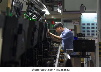 GUANGZHOU, CHINA - APR. 18. 2016: Workers assemble TV in TCL television assembly factory.