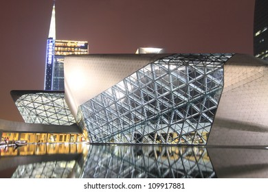 GUANGZHOU, CHINA - AUGUST 10: Guangzhou Opera house lights up for celebrating the 108th Canton Fair on August 10, 2012 in Guangzhou, China.