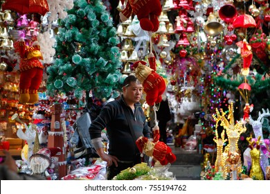 GUANGZHOU, CHINA - DEC. 24. 2014: People buying and selling New Year and Christmas decorations and trees on one of the biggest market for this in the world in Guangzhou.