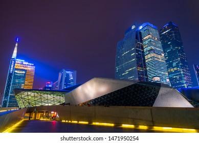 GUANGZHOU, CHINA - Dec. 29, 2018: night view of Guangzhou Opera House, skyscrapers and modern buildings in Zhujiang business center district, China. designed by Zaha Hadidis is famous worldclass arc